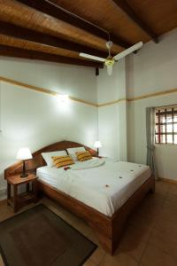 A bed or beds in a room at Heliconia Grove
