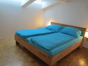 A bed or beds in a room at Ferienwohnungen Novak