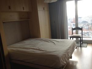 A bed or beds in a room at Apartment Nord Vrie 8D