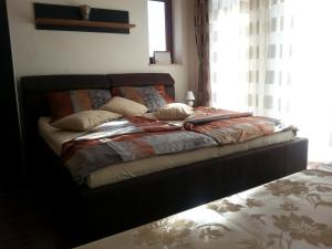 A bed or beds in a room at Haus Toscana