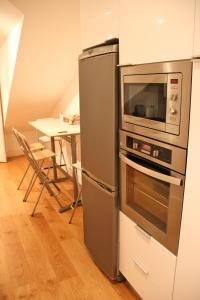 A kitchen or kitchenette at Miradouro de Lisboa