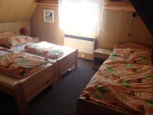 Posteľ alebo postele v izbe v ubytovaní Chata Machnatô - Jasná