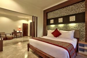 A bed or beds in a room at The Club Villas