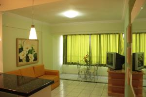 A television and/or entertainment center at Apartamento Paradise Residence