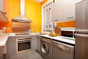 A kitchen or kitchenette at LetsGo Gran Via City Center