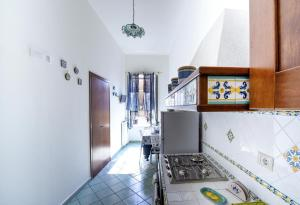 A kitchen or kitchenette at B&B Viacampo6