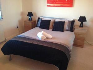 A bed or beds in a room at Langley Apartments - Portland Street