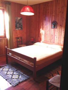A bed or beds in a room at Residence I Comignoli
