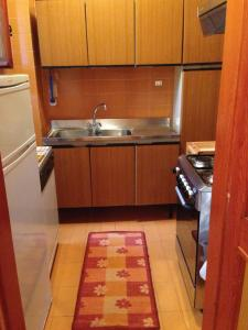 A kitchen or kitchenette at Residence I Comignoli