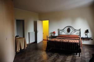Letto o letti in una camera di Villa Sargiano
