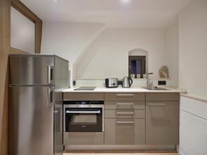 Cuisine ou kitchenette dans l'établissement Am Hofbrunnen
