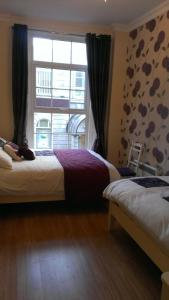 A bed or beds in a room at Wexford Town Apartment