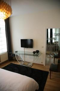 Et tv og/eller underholdning på Sablon-Aire Suite