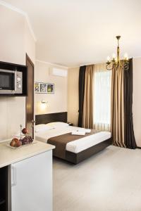 Łóżko lub łóżka w pokoju w obiekcie Apartments in City Center Area