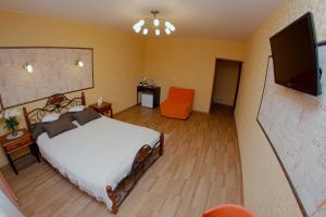 A bed or beds in a room at Moya kvartira 128