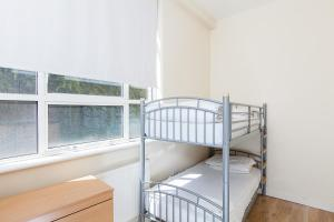 A bunk bed or bunk beds in a room at Access Euston