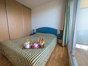 Un ou plusieurs lits dans un hébergement de l'établissement Résidence Mer & Golf Eugénie