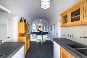 A kitchen or kitchenette at Domus Solis Luxury Villa