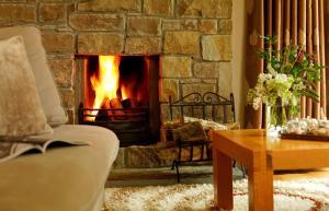 A seating area at The Woodland Villas at Parknasilla Resort