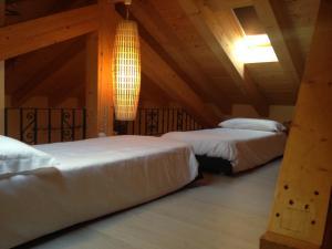Ein Bett oder Betten in einem Zimmer der Unterkunft Marco Polo Lodge
