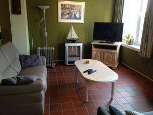 Ein Sitzbereich in der Unterkunft Lermitage Oostduinkerke