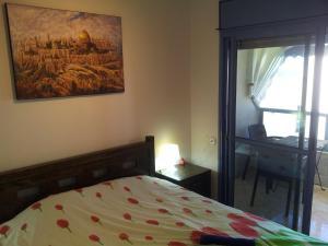 Gulta vai gultas numurā naktsmītnē Laguna Apartments