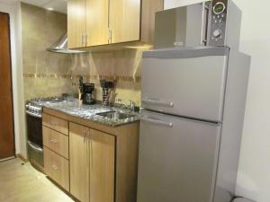 Una cocina o kitchenette en Apartment Costas Del Nahuel