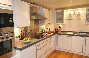 Küche/Küchenzeile in der Unterkunft Highland Apartments by Mansley