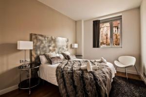 Säng eller sängar i ett rum på Sensation Sagrada Familia