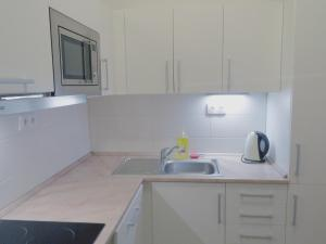 A kitchen or kitchenette at Apartments Verona Karlovy Vary
