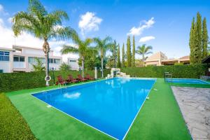 The swimming pool at or close to Estella Hotel Apartments
