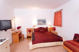 A bed or beds in a room at Anastasia Studios Lindos