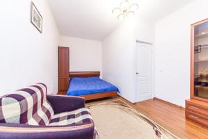 A bed or beds in a room at A-RENT na Mozhayskoy