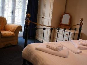 A bed or beds in a room at Bail Mews