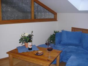 Ein Sitzbereich in der Unterkunft Landhaus Alpensee