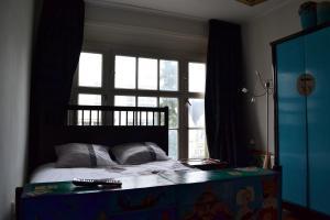 Een bed of bedden in een kamer bij Dols Apartment