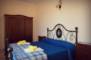A bed or beds in a room at La Costa Del Sole