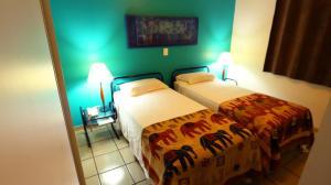 מיטה או מיטות בחדר ב-Mansoori Apart Hotel I