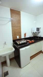 A kitchen or kitchenette at Mansoori Apart Hotel I