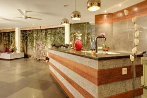 A kitchen or kitchenette at Elok Villas
