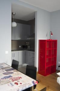 A kitchen or kitchenette at Apartamentos San Pablo