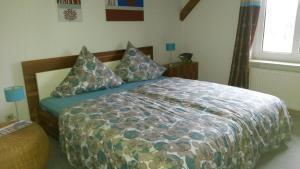 Ein Bett oder Betten in einem Zimmer der Unterkunft Apartments Schnepel