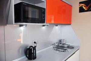 A kitchen or kitchenette at Apartament Numer 5