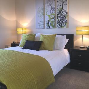 A bed or beds in a room at AB11 Apartments - Portland Street