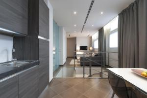 A kitchen or kitchenette at Brera Loft