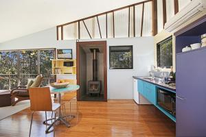 A kitchen or kitchenette at Lyola Pavilions in the Forest