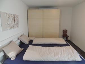 Ein Bett oder Betten in einem Zimmer der Unterkunft Got Pintg 8