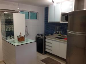 A kitchen or kitchenette at Porto Plaza Cupe Beach