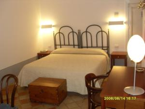 A bed or beds in a room at Residence Agave Lipari
