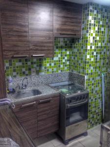 A kitchen or kitchenette at Nannai Residence Apartament